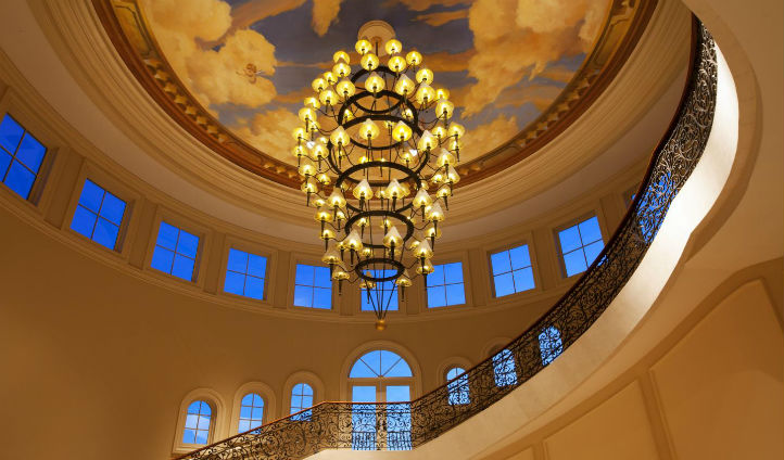 Golden chandeliers on the staircases