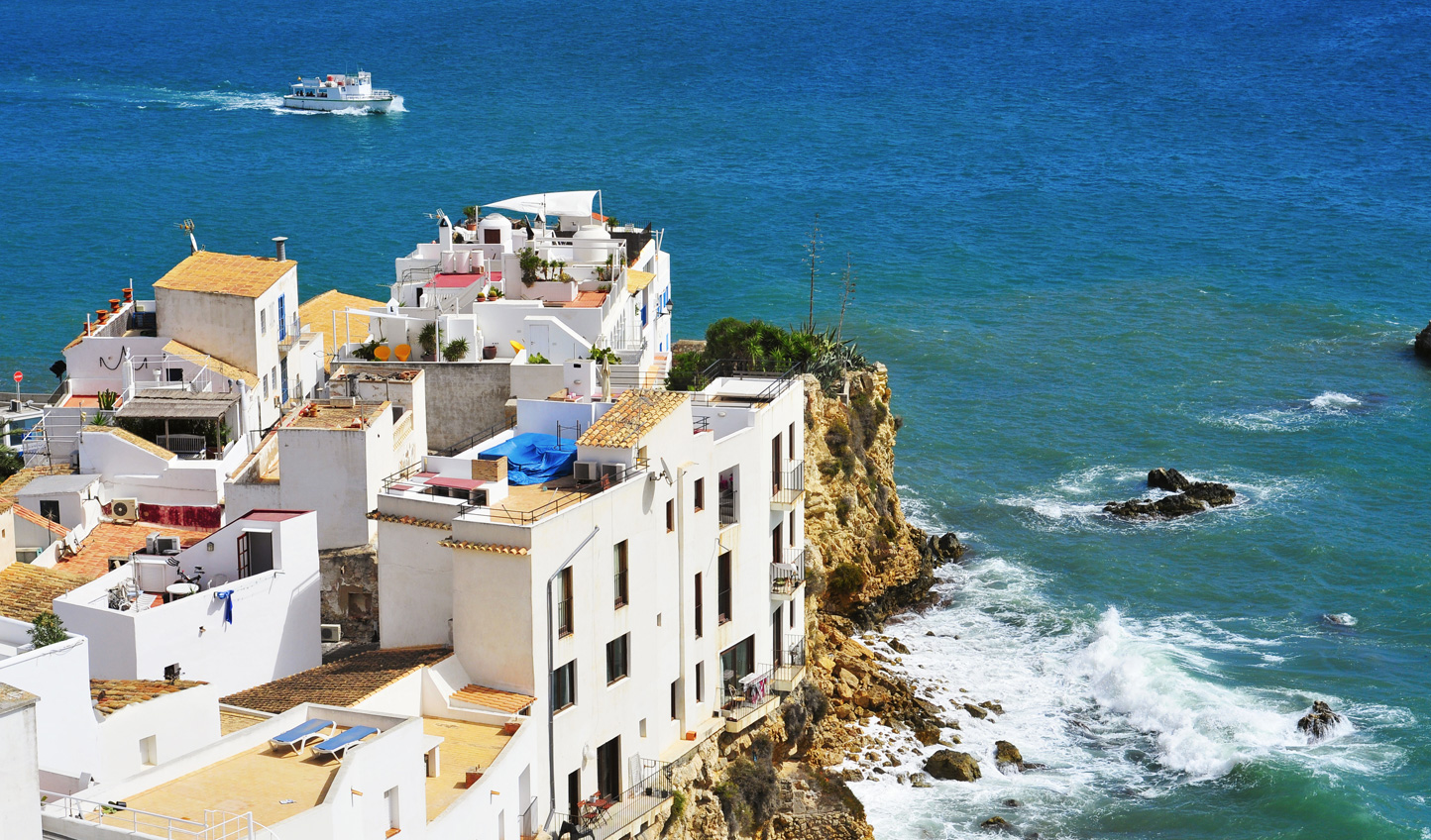 Discover whitewashed villages on rocky outcrops in Ibiza