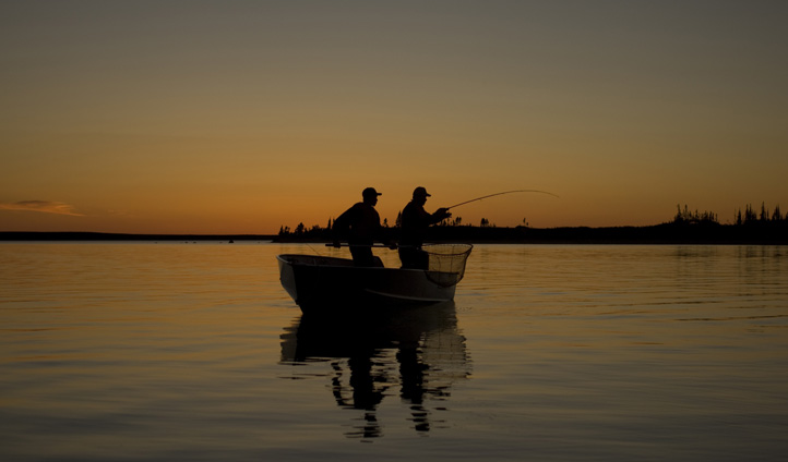Fishing under midnight sun, northwest Territories.