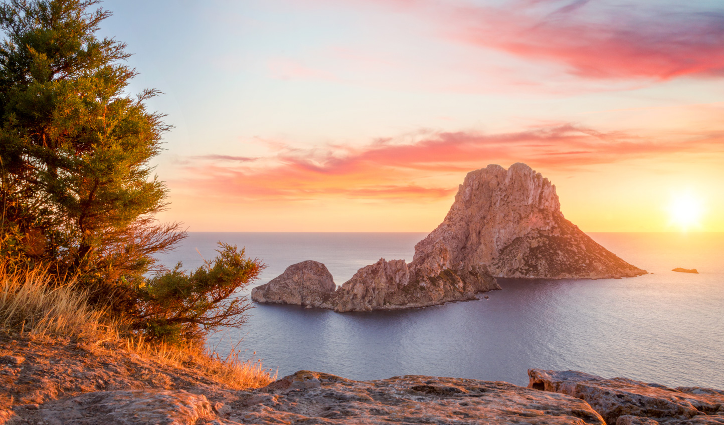 Watch in wonder as the sunset casts a ethereal glow over Es Vedra