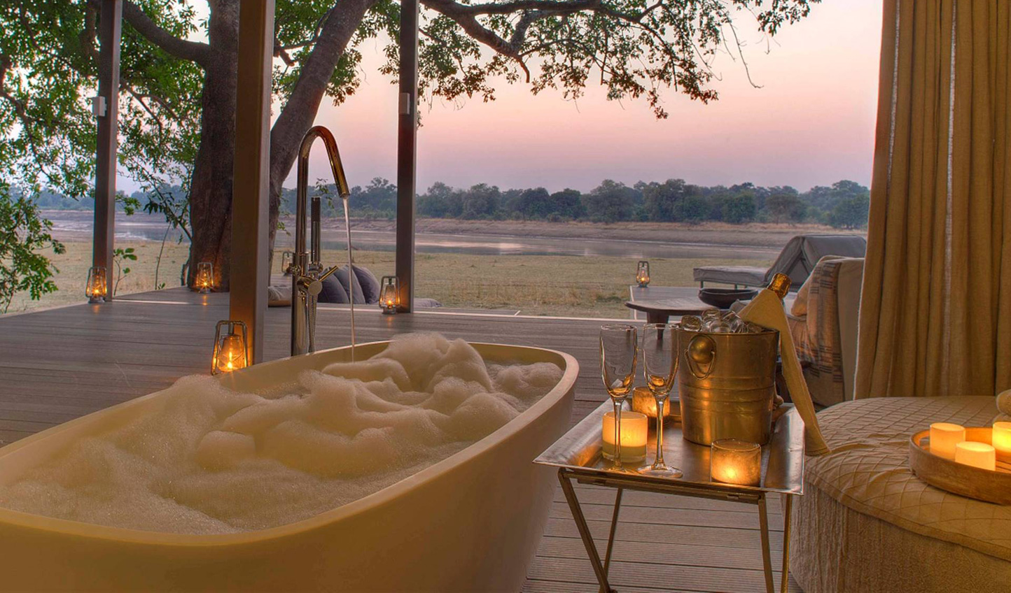Sink into the tub whilst watching the wildlife go by at Time + Tide Chinzombo