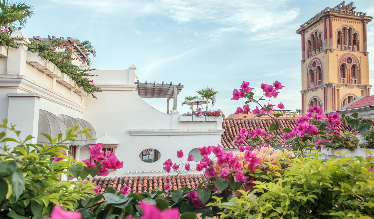 White washed Colonial buildings set against vibrant bougainvillea give Casa San Agustin irresistible charm