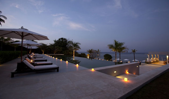 Take a dip in the candlelit pool and enjoy the starry sky