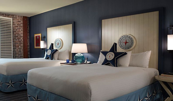 Your nautical bedroom offers sweeping views of the Fullerton Bay below