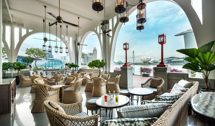 Sip on signature cocktails and dine on delicious nibbles over looking the Fullerton Bay