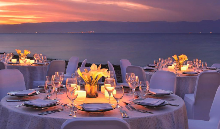 Dine in view of the sea at sunset