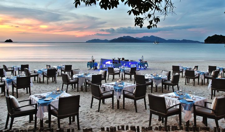Enjoy a beach side dinner at The Datai Hotel