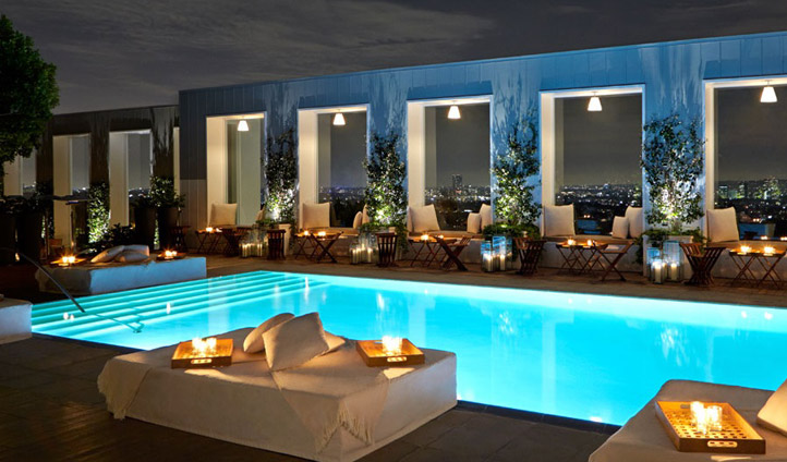 Enjoy a pool-side drink as night falls