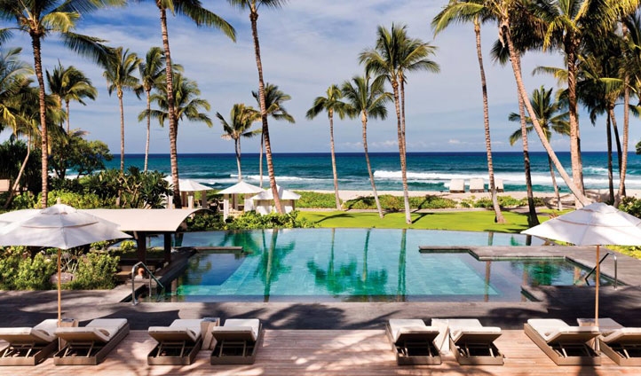 Take a dip in the tranquil pool surrounded by beautiful beach views