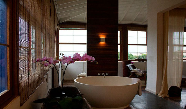 Take a dip in the large bathtub in your room with beautiful views of the tropical gardens