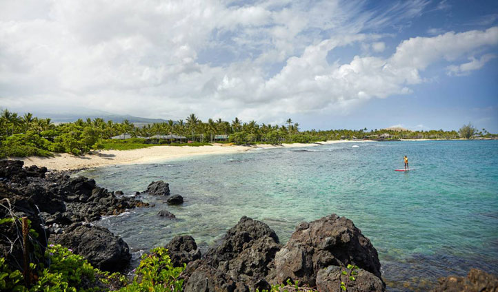 Take a stroll along the beach and gaze upon the surrounding islands