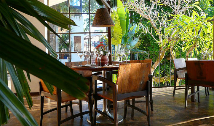 Enjoy a light lunch in the midst of your tropical surroundings