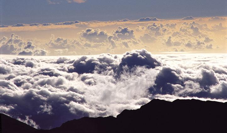 Climb up above the clouds, the volcanic island of Maui awaits
