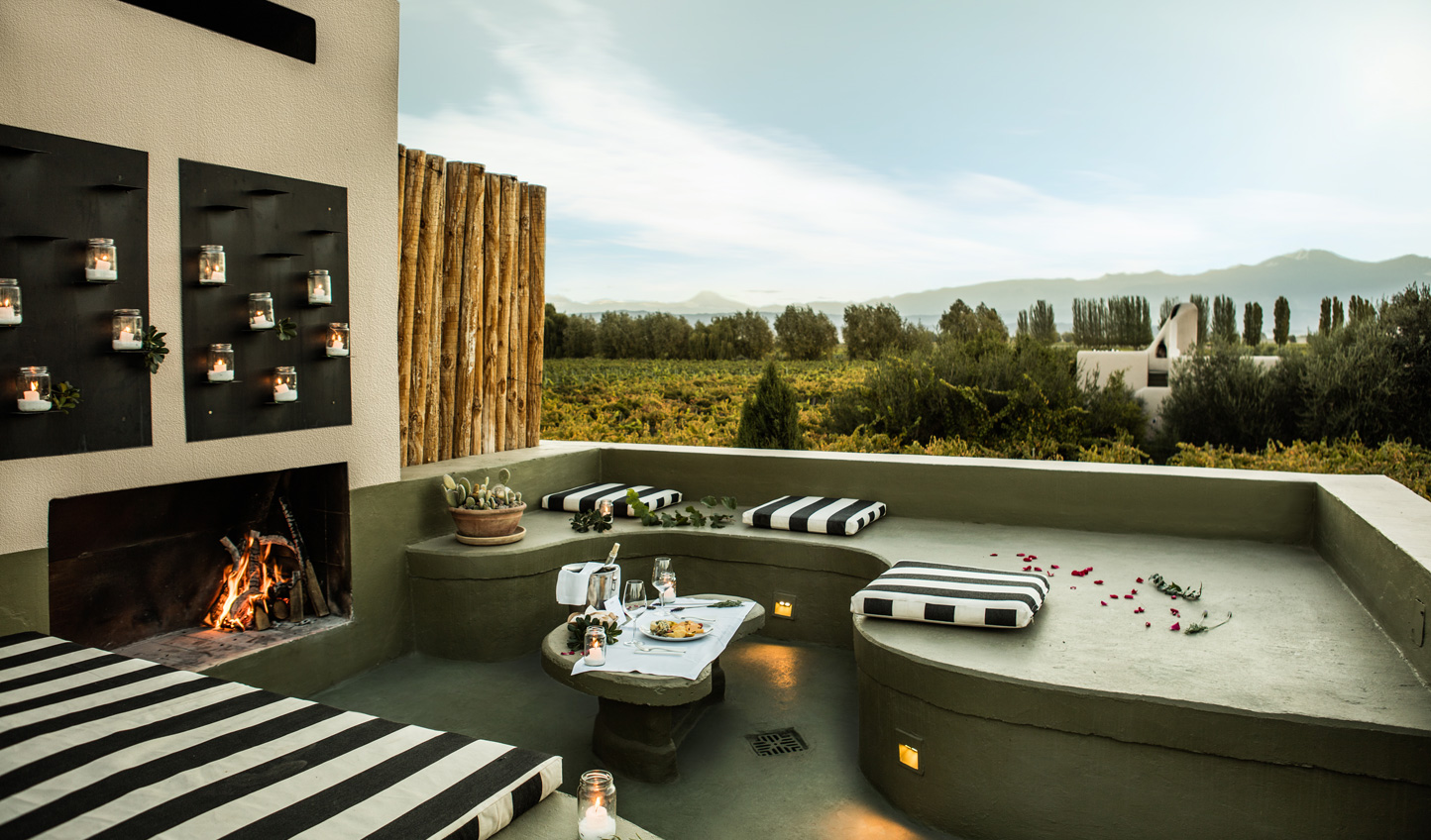 Curl up by the fireside and enjoy the view across Mendoza from Cavas Wine Lodge