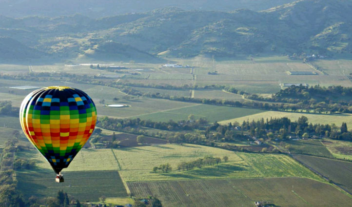 Take a hot air balloon ride and  soak in the views of the valley