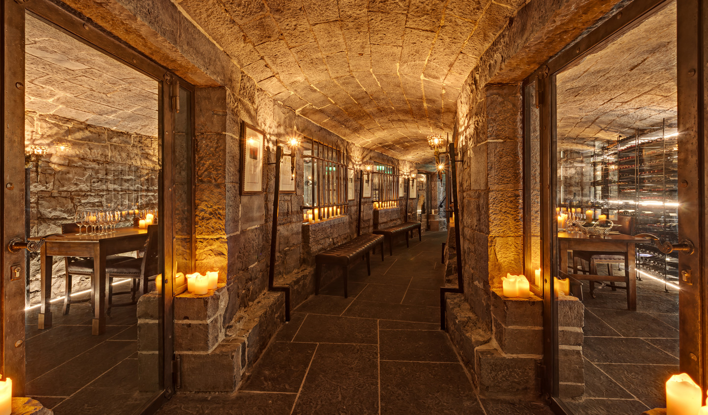 After dinner explore the wine cellars by candlelight