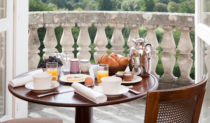 Have breakfast on the balcony overlooking the stunning grounds