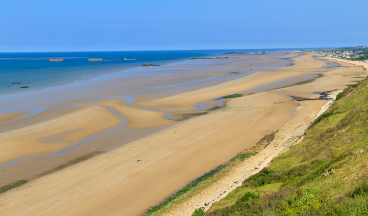 Reflect on the serene beauty of Normandy's beaches