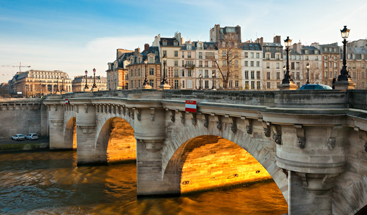 Catch the evening sun at the Pont de Neuf