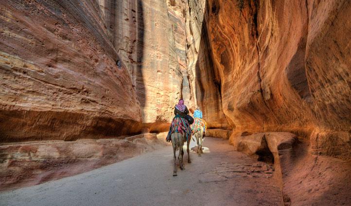 Ride through Petra's red rocks