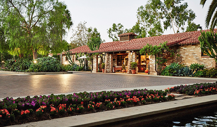 A sweeping driveway will take you to the doors of this ranch-inspired property