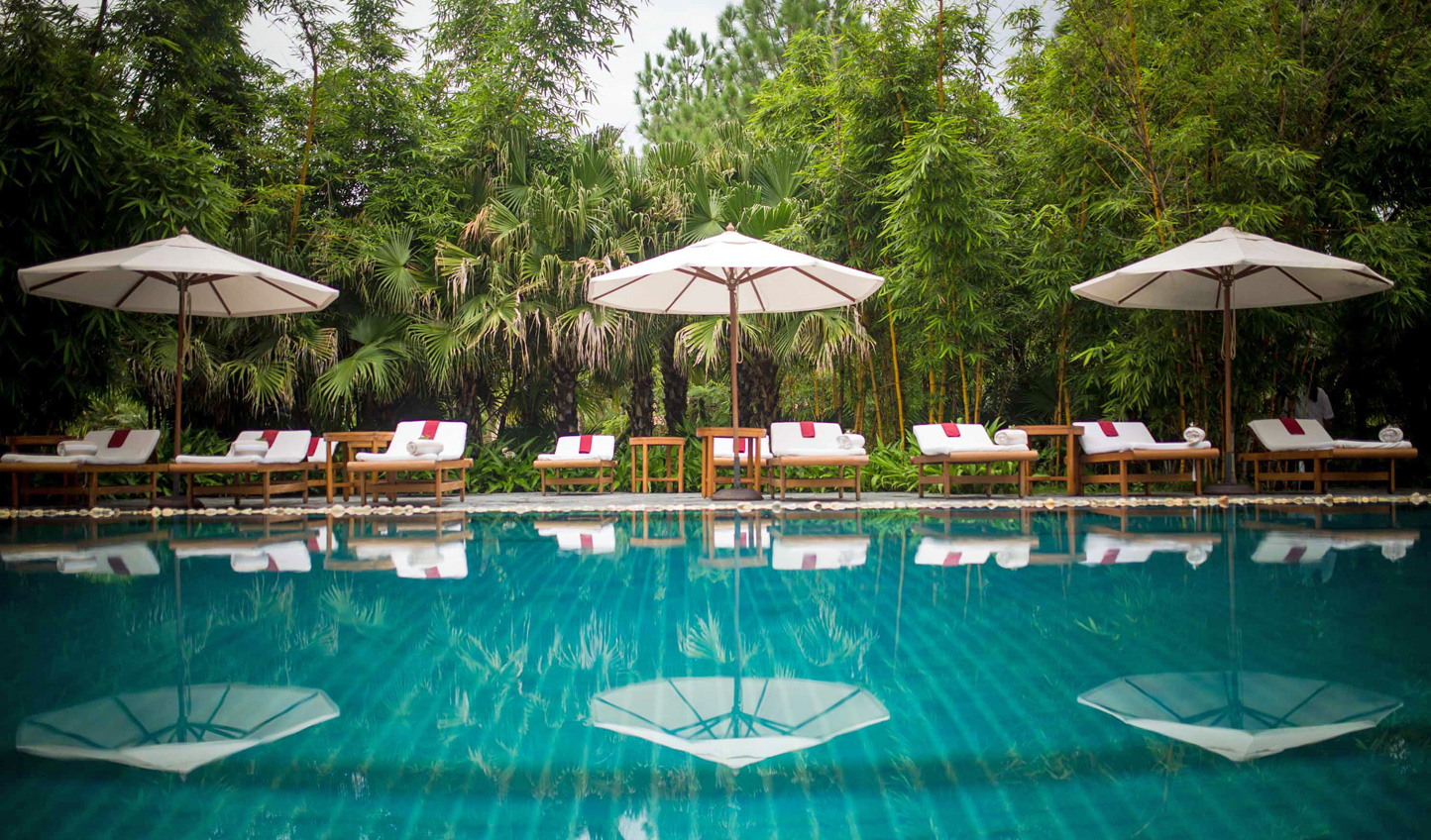 Relax by the pool at the Ananda