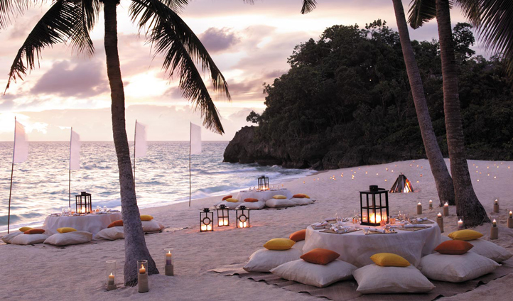 Watch the gentle waves over a beach dinner