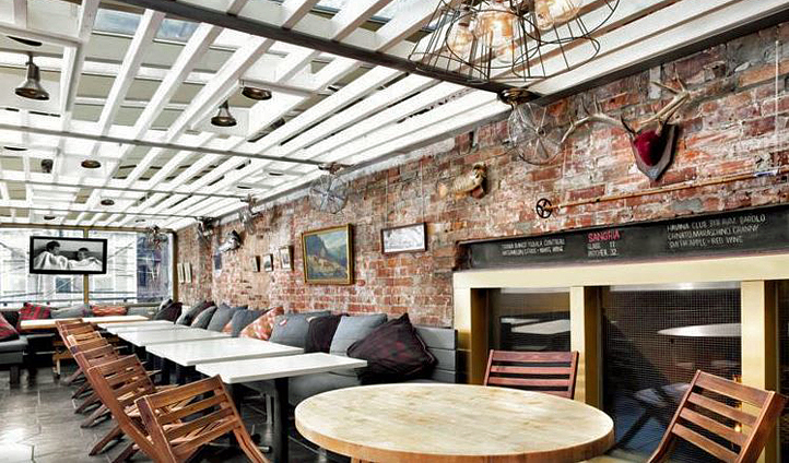 Exposed brick and wood reminds you you're somewhere chic