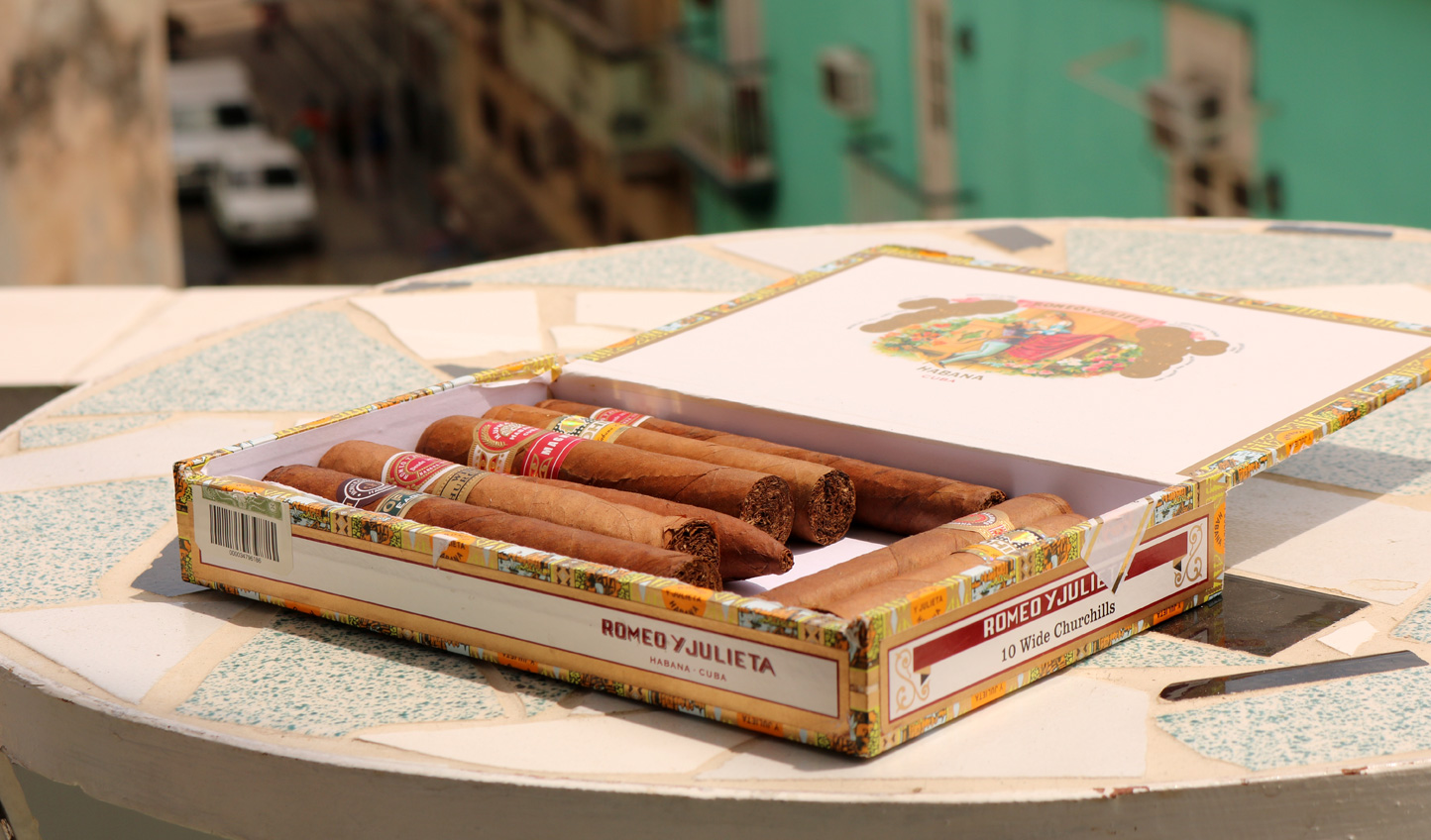 Watch the skilled craftsmen carefully roll cigars in Havana