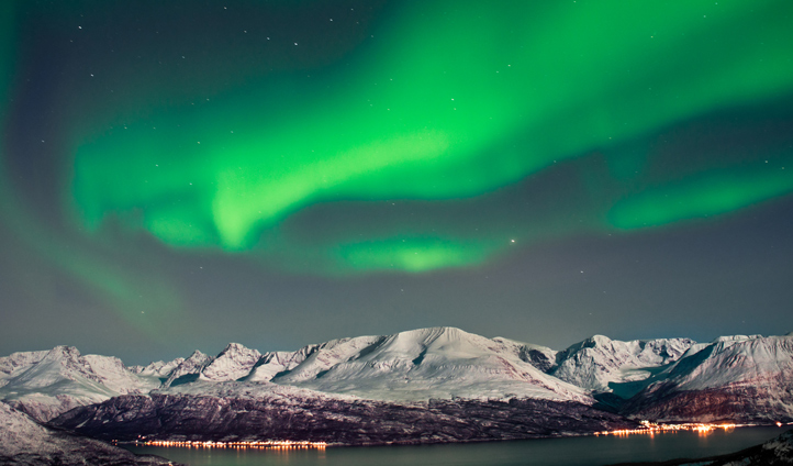 Aurora Borealis in all its glory over the fjords