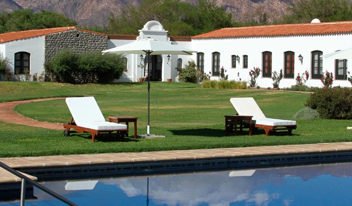 Unwind on sunloungers by the pool