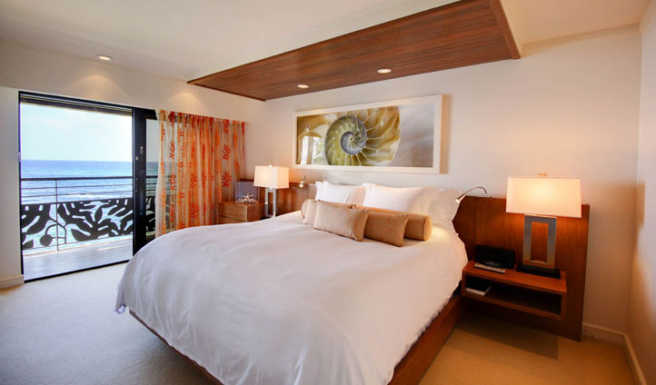 Large and luxurious beds overlook the water