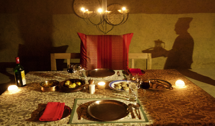 Enjoy traditional Himalayan dining under candlelight