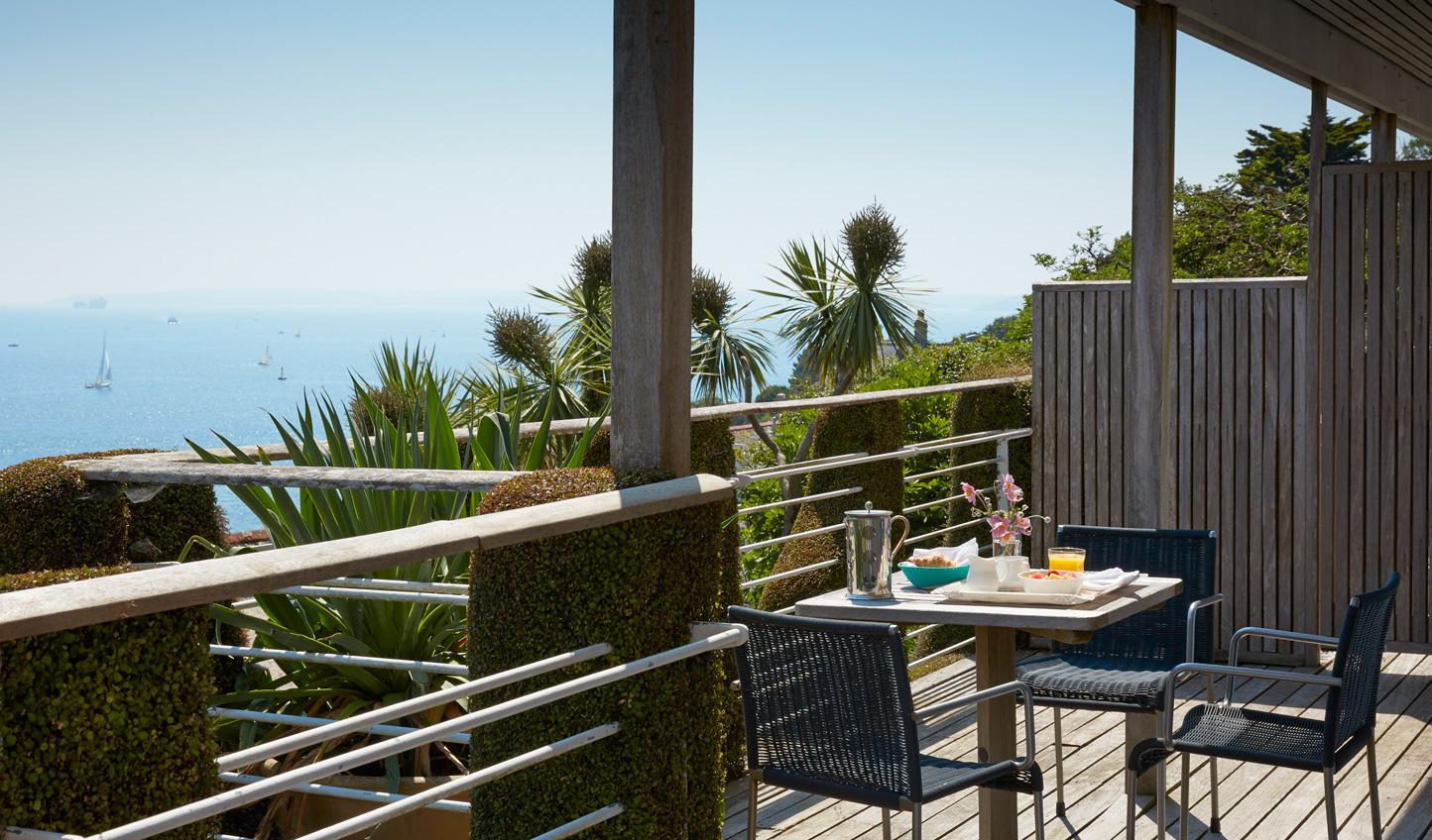 Enjoy breakfast al fresco with a view of the sea