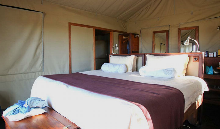 A double bedroom at Motswiri Camp, Botswana