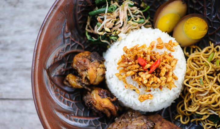 Indulge in Nasi Campur, a favourite dish amongst locals
