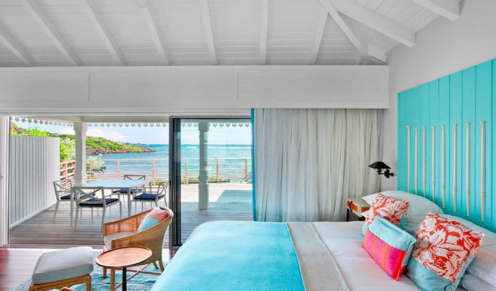 Your stylish room with a large terrace overlooking the endless ocean