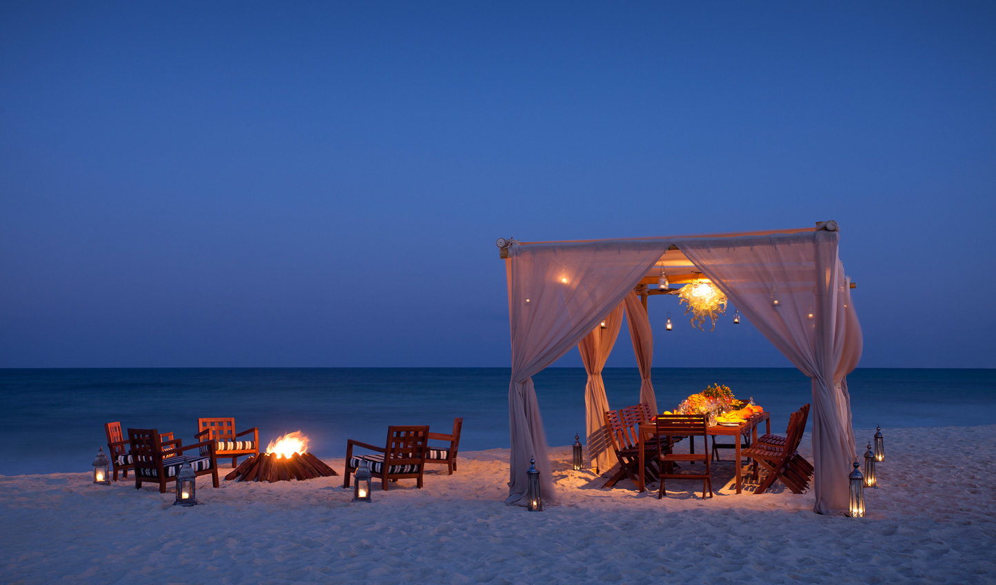 Dine beneath the stars with the sand between your toes