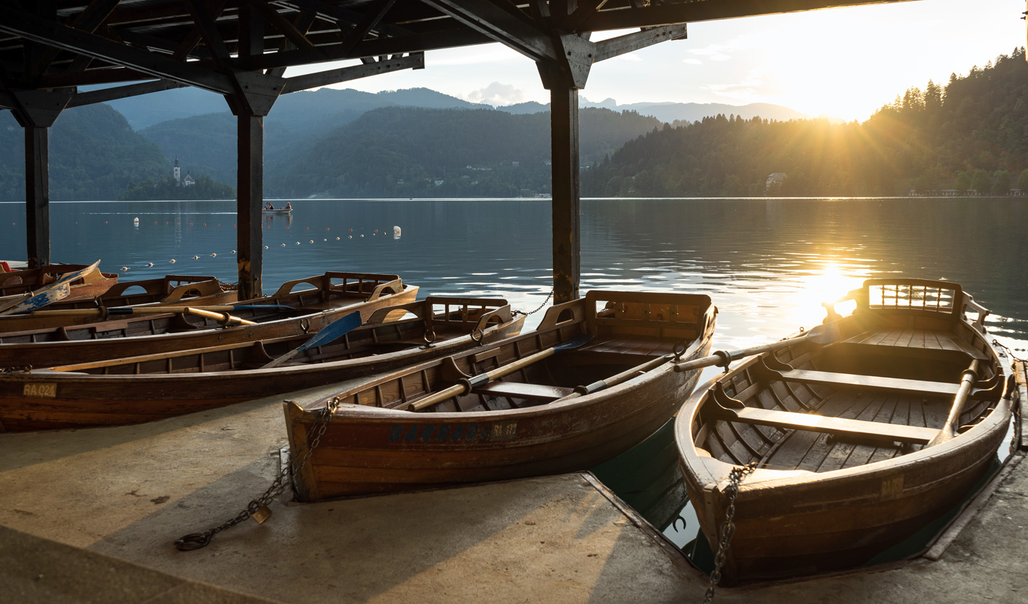 Sail across the tranquil waters of Lake Bled