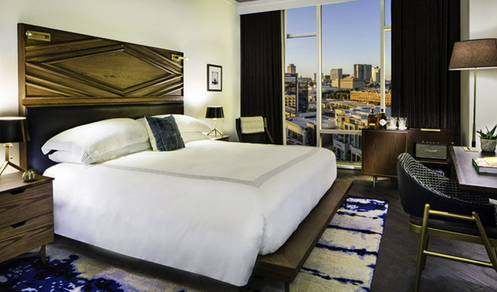 Overlook the city from your bedroom - Image © The Thompson Hotel