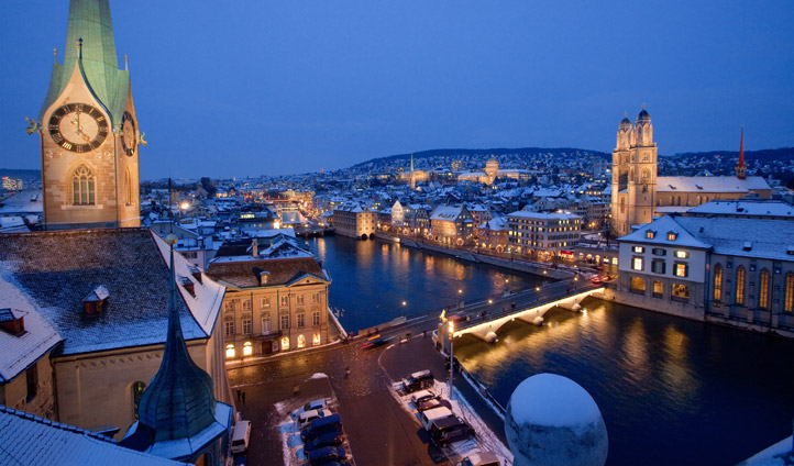 Night view over River Limmat, Zurich | Black Tomato