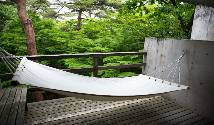 Relax on your hammock in the Japanese premier room