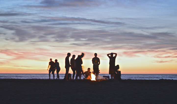 group around a beach campfire