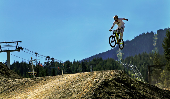 A mountain-biker soars in Whistler