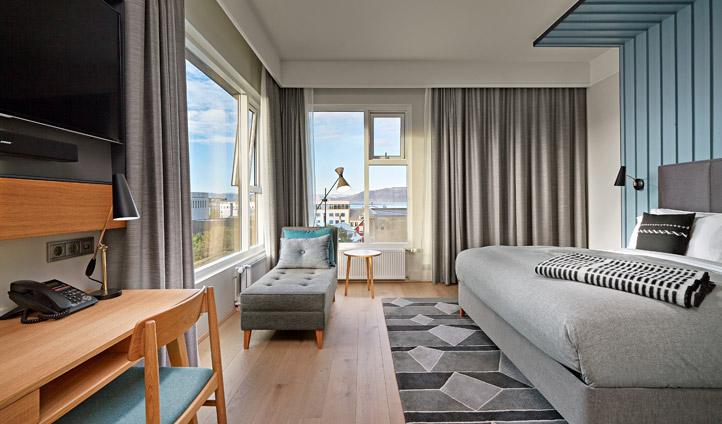 Lie in bed and look out to Reykjavik