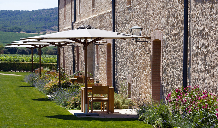 Enjoy a glass of wine on your private patio overlooking the gardens