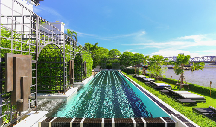 Take in the majestic views of the Chao Phraya River from the infinity pool