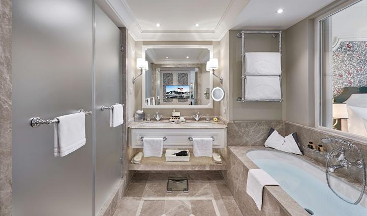 Bright marble bathrooms complement elegant bedrooms
