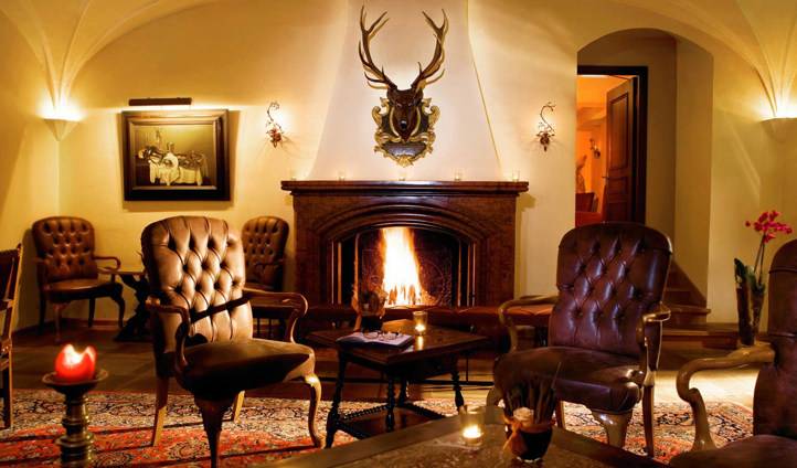Warm up by the fire in Schloss Bar