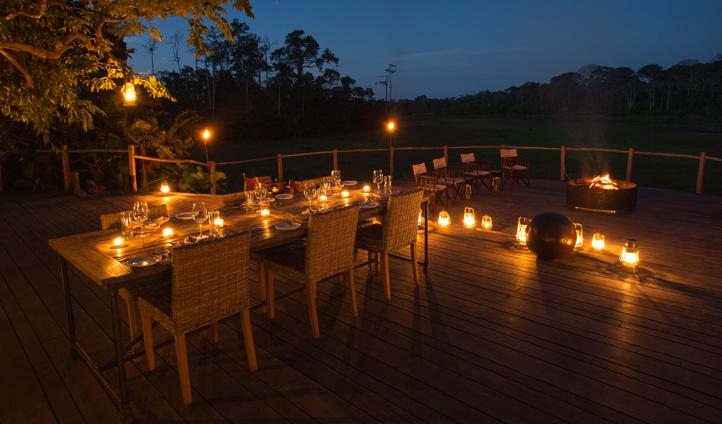 Enjoy a gourmet candle-lit dinner overlooking the bai at Lango Camp
